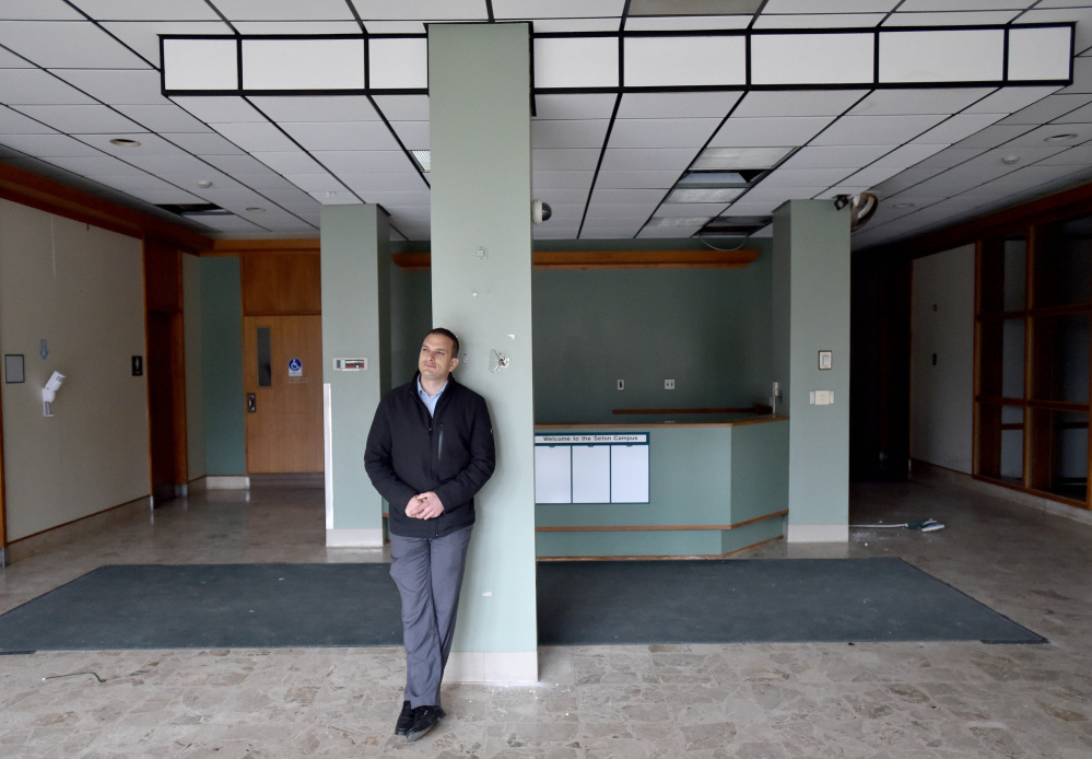 Tom Siegel stands in the lobby of the former Seton Hospital earlier this month in Waterville. The City Council on Tuesday voted on a tax increment financing deal so Siegel can renovate the building, turning it into office space and apartments.