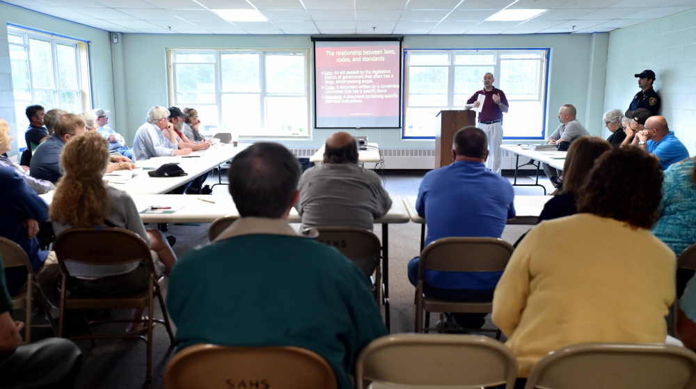 Landlords and property owners listen to Richard McCarthy, assistant state fire marshal, during a fire safety seminar at the Skowhegan Community Center on Wednesday.