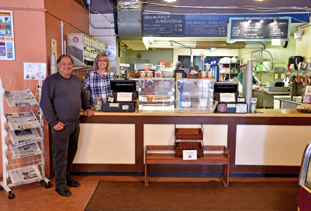 Steve Black, left, stands with Jorgensen's Cafe owner Ginny Bolduc, Wednesday in the cafe. Black was in the city representing financier Todd Robinson, who is buying the cafe, which will be run by his nephew.