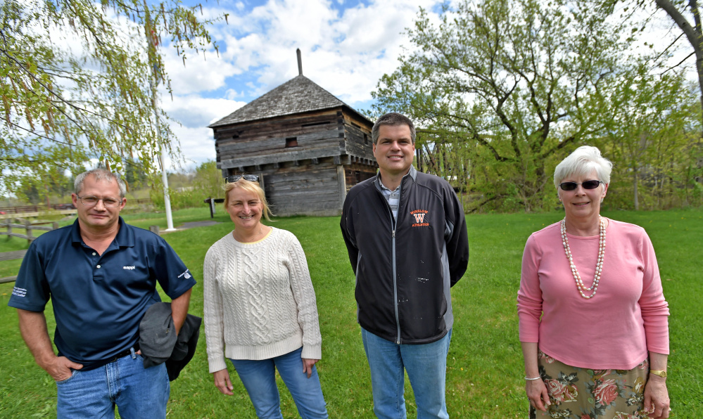 Fort Halifax Days committee members, from left, Ray Caron, Karen Rancourt-Thomas and Jim Bourgoin stand with Virginia Sturies, right, on Thursday in front of Fort Halifax in Winslow.
