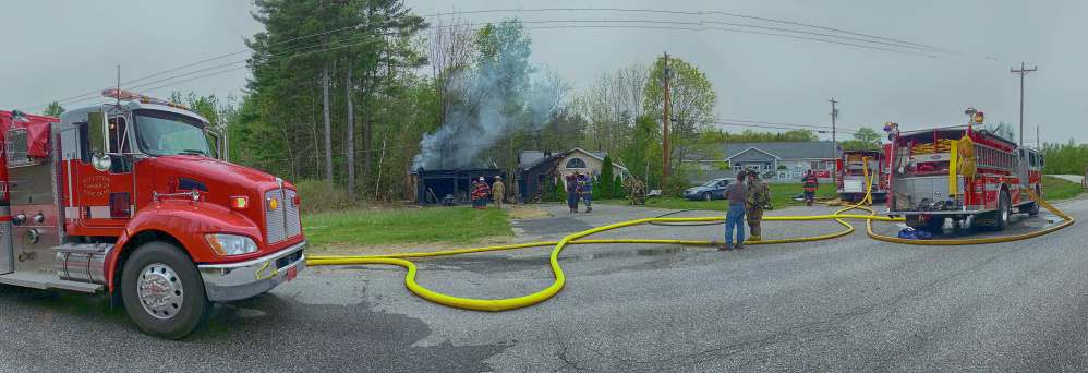 Firefighters from several departments work to put out a house fire Saturday on Pushard Lane in Gardiner.