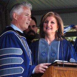 Colby College President David Greene confers an honorary degree of Doctor of Letters on commencement speaker Arianna Huffington, co-founder of the Huffington Post, on Sunday.