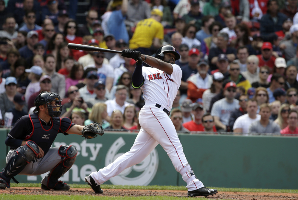 Boston's Jackie Bradley Jr., right, singles as Cleveland's Yan Gomes, left, looks on in the fifth inning Sunday at Fenway Park in Boston.