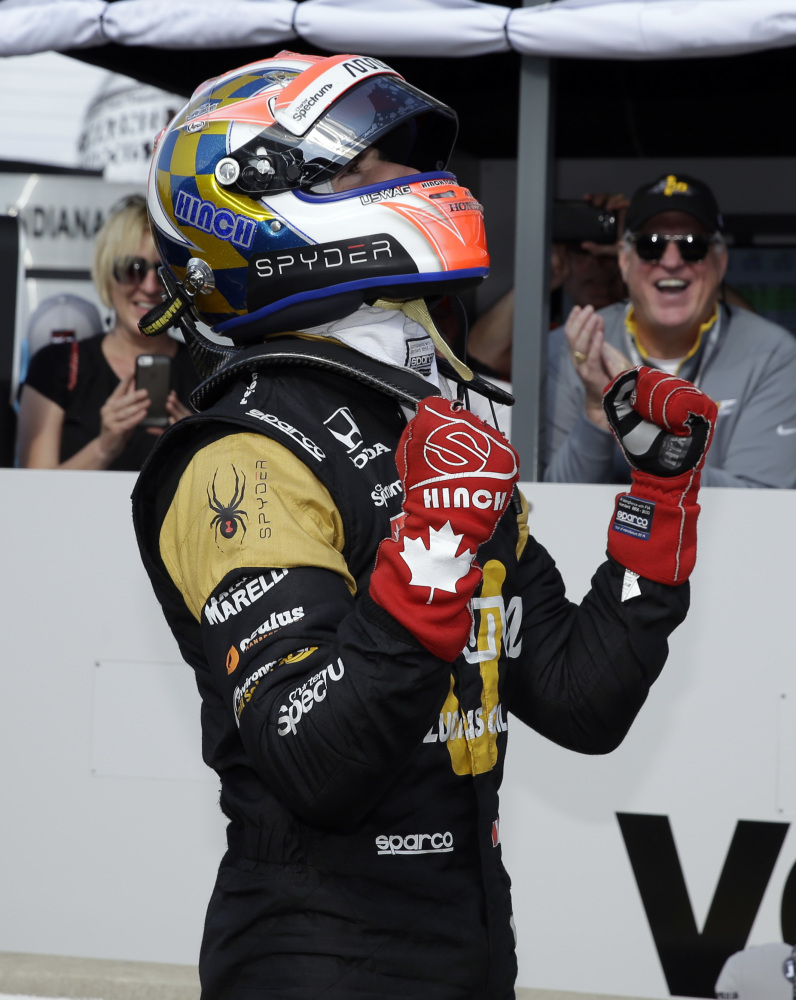 James Hinchcliffe celebrates  after winning the pole during qualifying for the Indianapolis 500 at Indianapolis Motor Speedway on Sunday in Indianapolis.