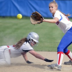 Hall-Dale's Isabella Marino, left, slides back into second base while Oak Hill's Brooke Surette waits for the throw Monday in Wales.