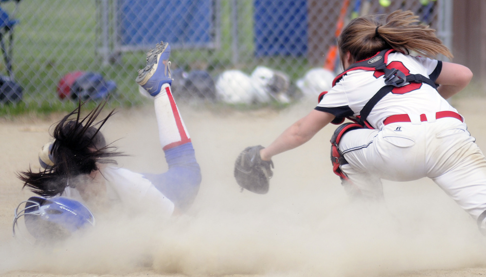 Hall-Dale's Emma Begin can't reach Oak Hill's Jamie Prue at home Monday in Wales.