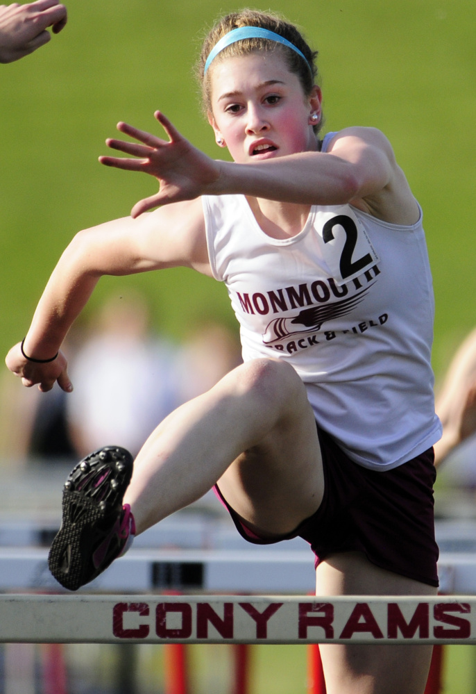 Monmouth Academy's Emily Grandahl runs 100 meter hurdles during a meet last Friday at Alumni Field in Augusta.
