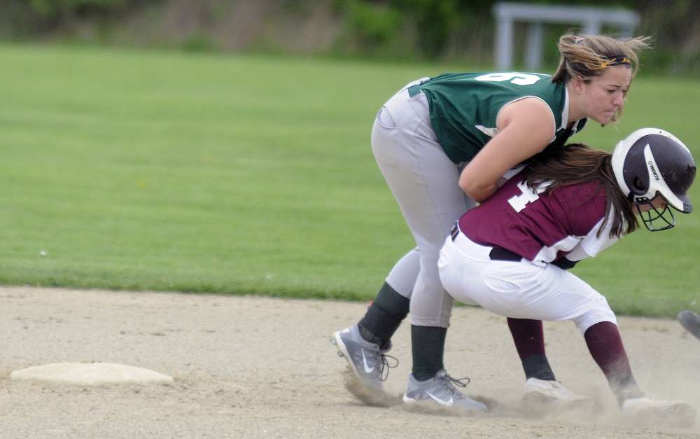 Richmond runner Meranda Martin, right, collides with Temple Academy's Jaimee Feugill by second base during an East/West Conference game Tuesday afternoon in Richmond.