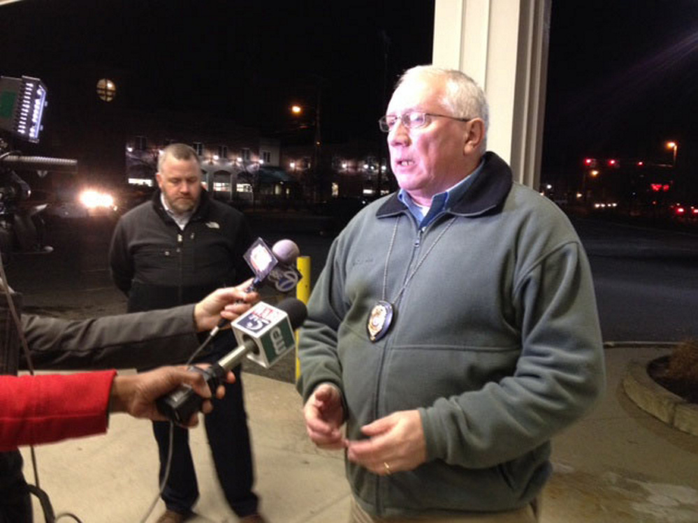 Police Chief Joseph Massey, right, speaks to reporters in December during a night-long standoff as Deputy Chief Charles Rumsey listens in background. Rumsey is leaving next week to become chief in Cumberland, and Massey has asked City Councilors to fill the $92,000-a-year position, which he said is crucial to running the department.