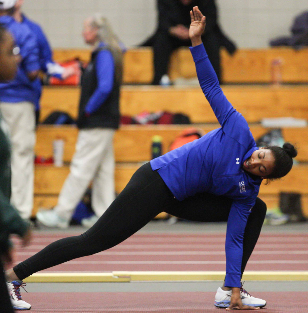 Kim Donaldson stretches before a meet recently. The Colby senior is headed to the NCAA Division III nationals despite this being her first season throwing the shot. (Contributed photo)
