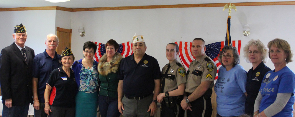 Volunteers George Thomson, left, and Greg Couture, Post 181 Litchfield; event organizer Deb Couture; guest speaker Rep. Gay Grant; speaker Laura Allen, State of Maine Bureau of Veteran's Services; Speaker Deo Laurias, American Legion State Service Officer; volunteers Deputy Jess Poulin and Cpl Ivano Stefanizzi, Kennebec County Sheriff's Office; Event Organizer Denise Emery; Service Officer Eileen Krawczyk, and Speaker LaRhonda Harris, Togus Women Vets Coordinator.