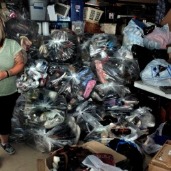Amie Cunningham, manager of the Somerset Humane Society Animal Shelter in Skowhegan, speaks beside bags containing 2,800 pair of shoes the organization collected that will be donated to poor citizens in third world countries.