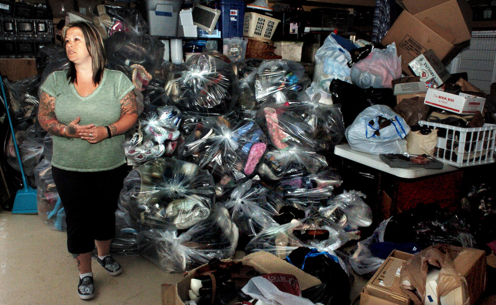 Amie Cunningham, manager of the Somerset Humane Society Animal Shelter in Skowhegan, speaks beside bags containing 2,850 pairs of shoes the organization collected that will be donated to people in impoverished countries.