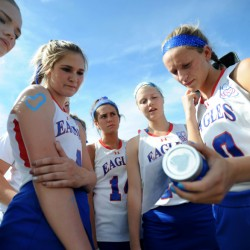 Messalonskee High School's Riley Field (10) far right, holds a jar of sand representing dreams with a picture of fallen friend and teammate, Cassidy Charette, as she stands with teammates Brianna Leonard (9) far left, Emily Hogan, second from left, India Languet (14) center, and Nathalie St. Pierre (18), second from right, at Thomas College in Waterville on Thursday.