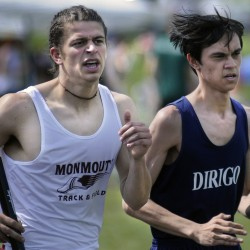 Monmouth Academy's Luke Tombs, left, passes Chad Berry, of Dirigo, in the 4x800 relay at the Mountain Valley Conference outdoor track and field championships Thursday in Lisbon Falls.