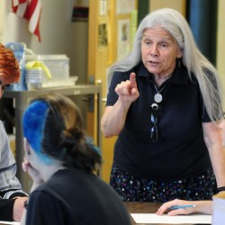 Mary Dyer, who is retiring this year, talks to students Thursday during a drawing lesson in art class at Winthrop High School.