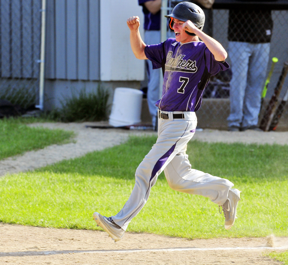 Waterville pinch runner Kody Vallee celebrates as he heads home to score the tying run on a single by Andrew Roderigue in the top of the seventh inning during a Kennebec Valley Athletic Conference Class B game against waterville on Friday in Readfield.