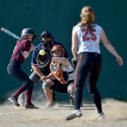 Winslow pitcher Hillary Libby throws a ball high and tight on Nokomis hitter Alyssa Ellis during a Kennebec Valley Athletic Conference Class B game Friday afternoon.