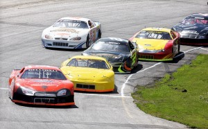 Dave St. Clair, of Liberty, second from left, battles for the lead with Wayne Helliwell, Jr. during a 2014 Coastal 200 qualifying heat at Wiscasset Speedway on Sunday. The annual race is Sunday.