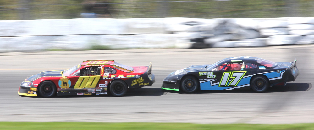 Sidney native Chris Thorne, in the No. 17 car, tries to get by Alex Waltz during a qualifying heat for the 2014 Coastal 200 at Wiscasset Speedway. Thorne, a three-time track champion, is one of the favorites in the race Sunday.