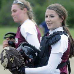 Richmond catcher Meranda Martin, right, stands by teammate Sydney Tilton on Tuesday during a game with Temple Academy.