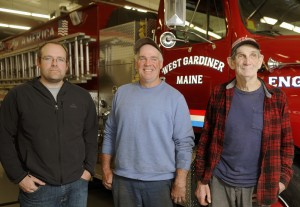 Three generations of Hickeys serve the town of West Gardiner. From left, Gary Hickey II, who is the town's volunteer fire chief; his father, Gary, who is the road commissioner; and his grandfather, Selectman Mert Hickey, gather last week at the fire station in West Gardiner.