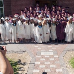 The class of 2016 poses for photos Saturday in front of Bearce Hall before the graduation ceremony at Kents Hill School in Readfield.