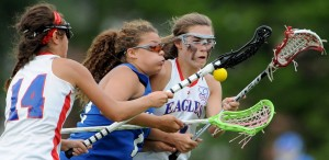 Lewiston's Alasia Branche, middle, battles for the ball with Messalonskee's India Languet (14) and Lauren Pickett during an Eastern Maine Class A semifinal game last season at Thomas College in Waterville.