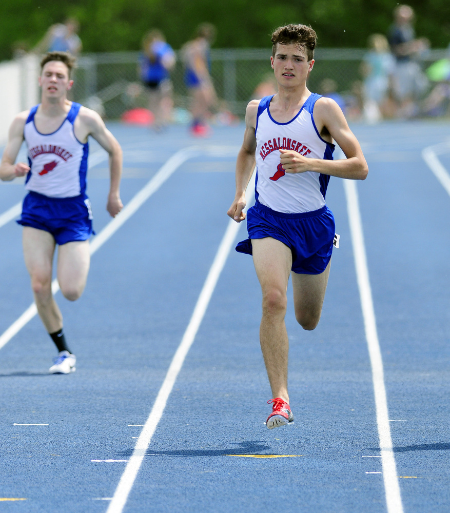 Staff photo by Joe Phelan   Messalonskee's Carson Bessey, left, and Zach Hoyle run the 400 meters at the Kennebec Valley Athletic Conference championship meet Saturday at McMann Field in Bath.