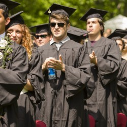 Bates College graduates applaud Rep. Lewis during the commencement ceremony Sunday.