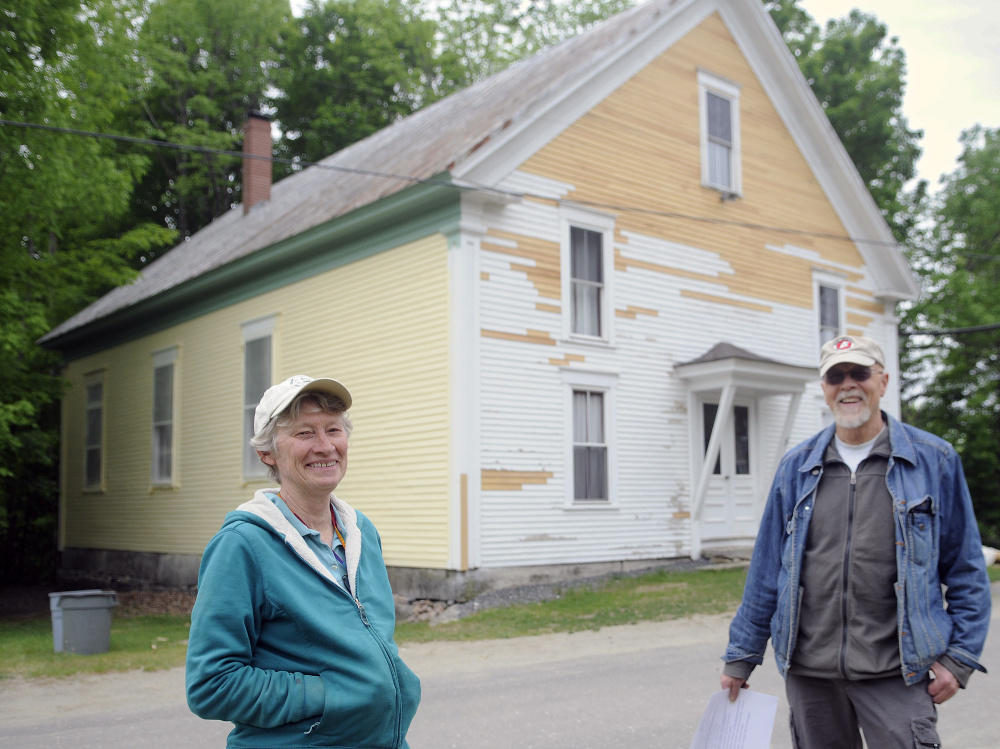 The Vienna Union Hall that stands behind Marianne Archard, president of the Vienna Union Hall Association, and her husband, John Archard, on Sunday is receiving a new coat of paint.