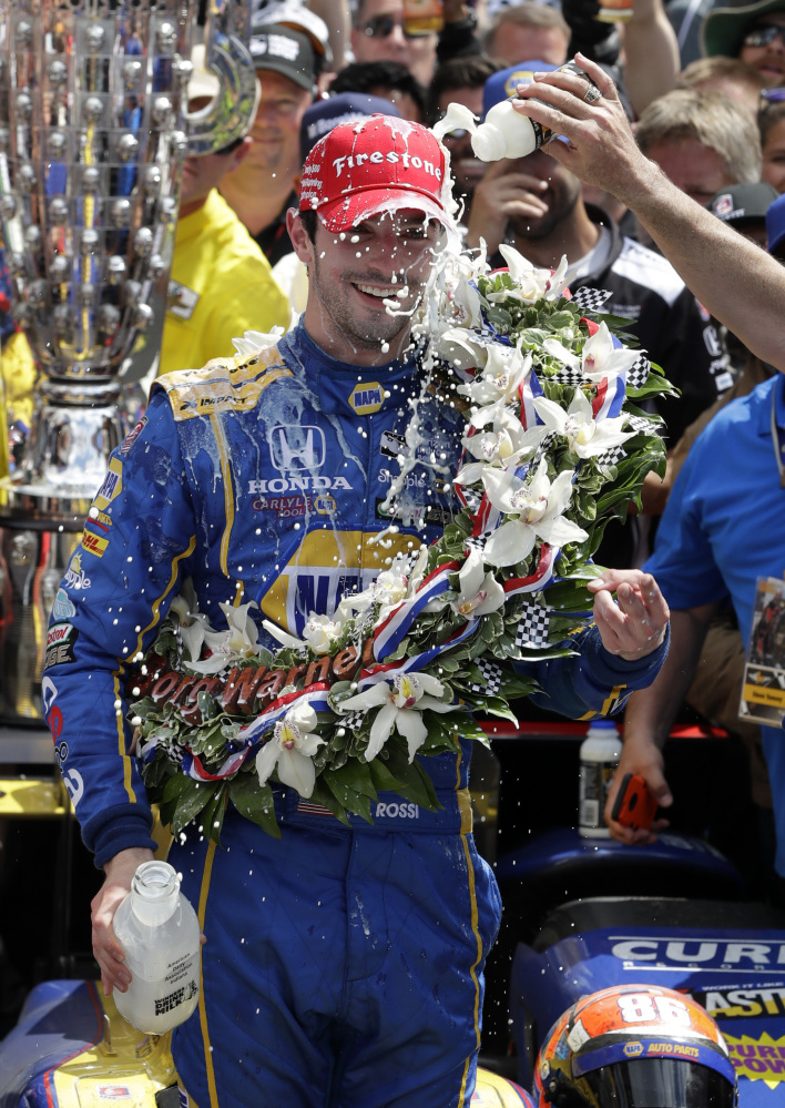 Alexander Rossi celebrates after winning the 100th running of the Indianapolis 500 on Sunday at Indianapolis Motor Speedway in Indianapolis.