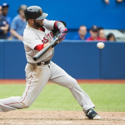 Boston Red Sox's Dustin Pedroia hits an RBI double against the Toronto Blue Jays during the 11th inning Sunday in Toronto.