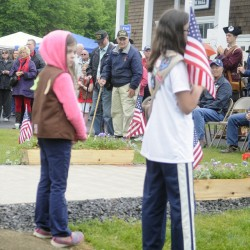 Veterans stand to be recognized during a Memorial Day Service at the Sidney Town Hall on Monday.