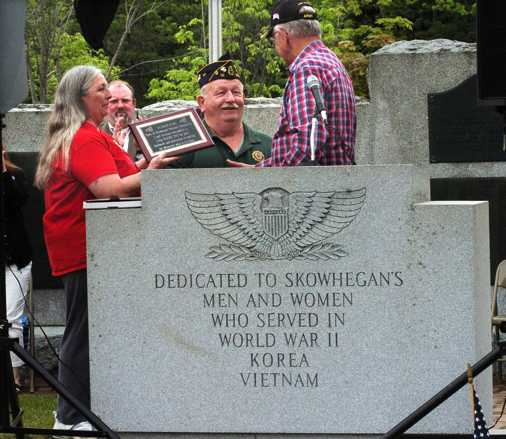 Veterans Memorial Park organizer Tom McCarthy recognized the volunteer efforts and contributions of Ann and Steve Spaulding at the end of the Skowhegan Memorial day parade on Monday