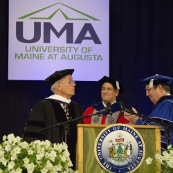 Professor Barry Farber, left, accepts his Honorary Doctorate of Humane Letters from UMA Provost Joseph Szakas, middle, and UMA President James Conneely.