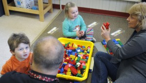 Head Start students play Dec. 8, 2015, with Webster Head Start Center assistant teacher Sharon Bissonnette and education technician Ervin Fyle at the Augusta site. The Head Start program is among several in Kennebec County managed by the Southern Kennebec Child Development Corp. in Farmingdale, which is receiving $2.78 million in federal funding.