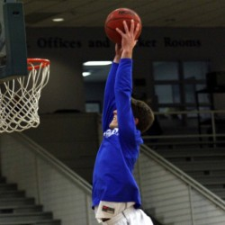 Colby College guard Pat Dickert goes up for a dunk prior to a game last season. Dickert, who is listed at 6-foot-2, made national headlines after he posted a video of himself dunking from behind a foul line.