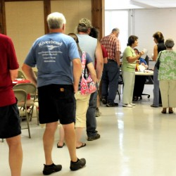 Voters wait for polls to open at the Farmington Community Center for last year's Regional School Unit 9 budget vote. It was the second time the district voted on the budget last summer. School officials hope changing the process this year will result in passage on the first vote at the polls Wednesday.