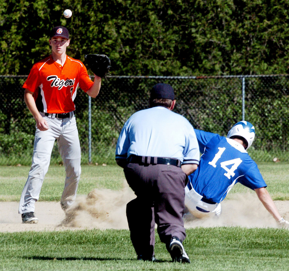 Erskine runner Luke Peabody makes it to third base as Gardiner third baseman Nic Berube waits for the throw during a Kennebec Valley Conference Class B game Tuesday in Gardiner.