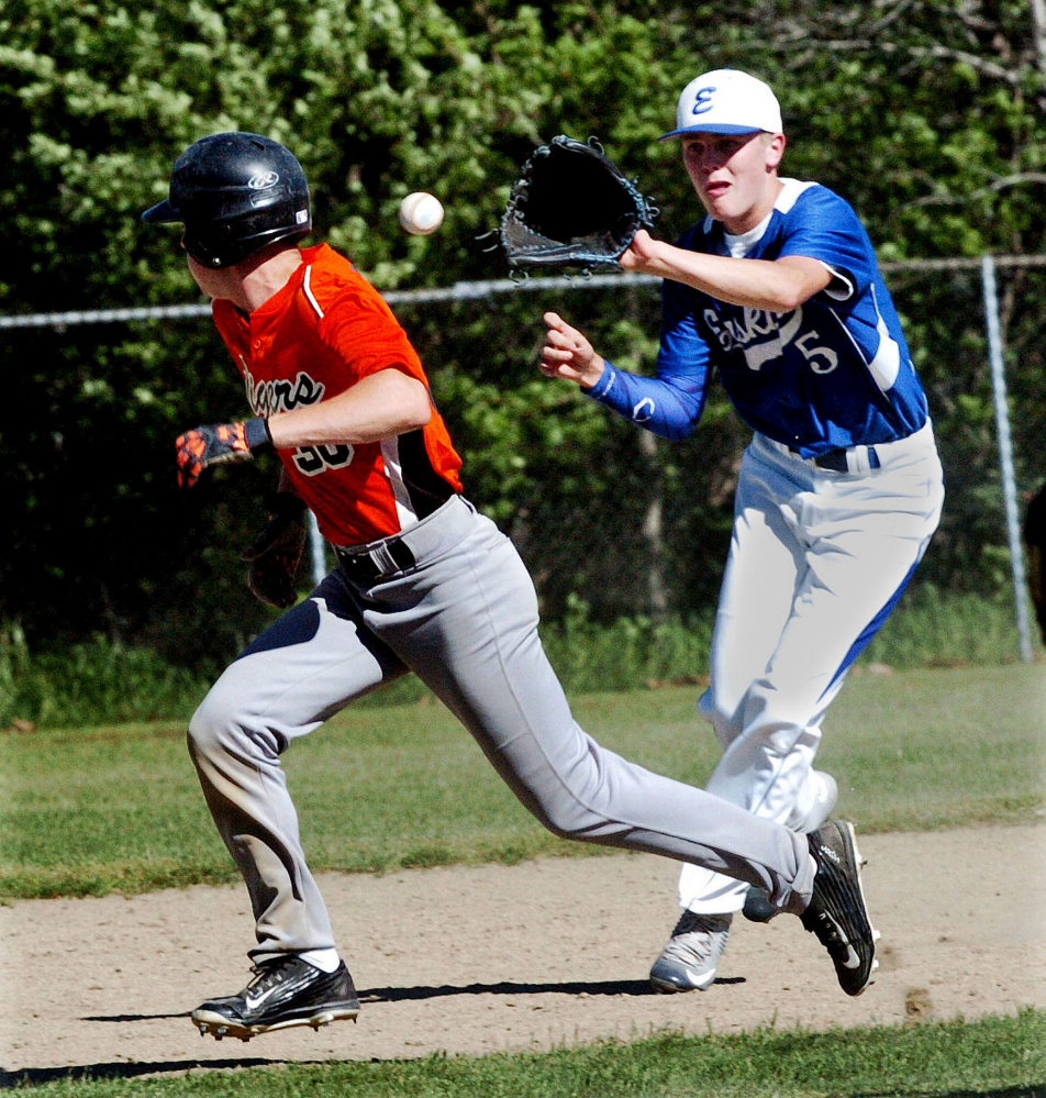 Erskine shortstop Dylan Presby fields the ball as Gardiner runner Isiah Swan heads to third during a Kennebec Valley Athletic Conference Class B game Tuesday in Gardiner.