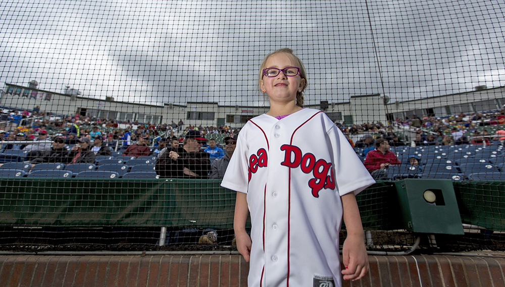 "Emma Dube, a liver cancer survivor, prepares to run the bases at Hadlock Field. Emma is this year's first ""Heroes at Hadlock"" honoree. Ben McCanna/Staff Photographer"