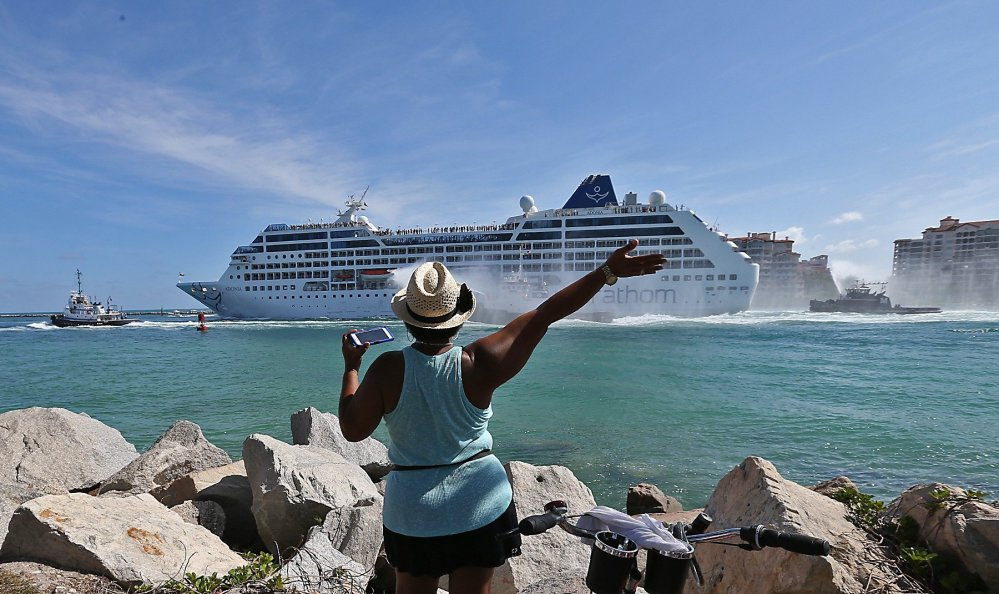 A woman from Cuba waves Adonia leaves port in Miami en route to Cuba.