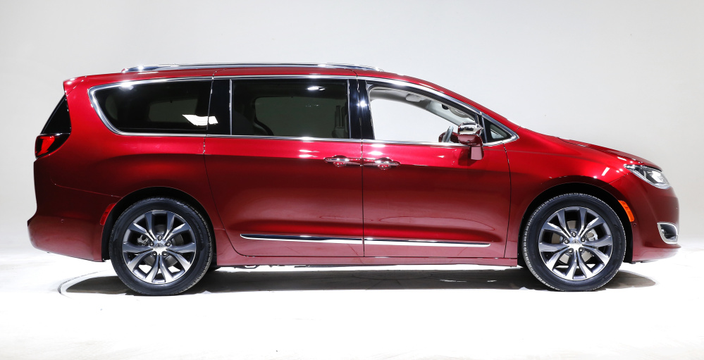 Google and Fiat Chrysler engineers will equip 100 Pacifica gas-electric minivans, like the one above, with self-driving technology at a work site near Detroit.