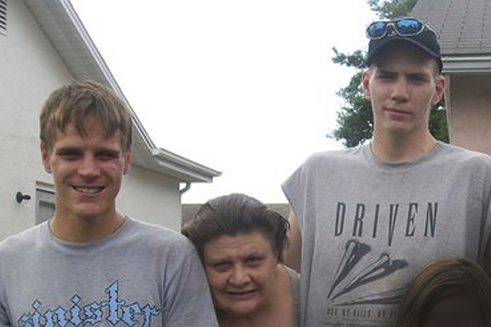 This 2010 family photo shows the twin brothers, Jarred, left ,and Timothy Johnson, with their mother, JoAnn Winters, who died in January. Jarred says the family petitioned the court to involuntarily commit Timothy, but the order was never carried out. Timothy F. Johnson now stands accused in the slaying of 52-year-old Judith Therianos in New Port Richey, Fla., in March. (Note: This photo has been intentionally blurred to protect the identity of a minor, lower right.)