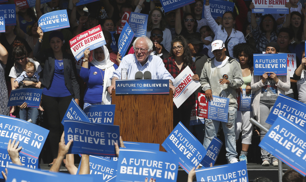 Sign-waving fans show their support for Democratic presidential candidate Bernie Sanders at a campaign rally Tuesday in Stockton, Calif. The state's primary is scheduled for June 7.