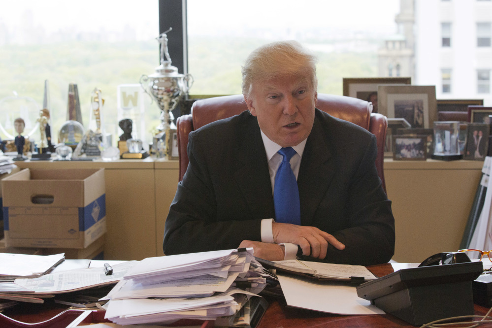 Donald Trump gives an interview in his office at Trump Tower in New York in May.