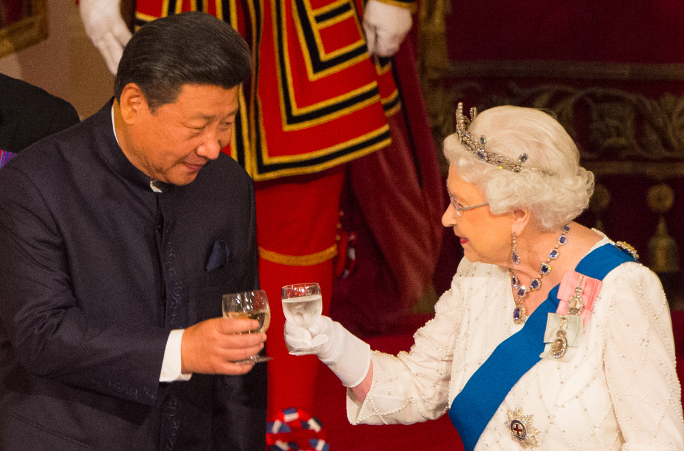 Chinese President Xi Jinping toasts Britain's Queen Elizabeth II during a state banquet at Buckingham Palace in London last fall.