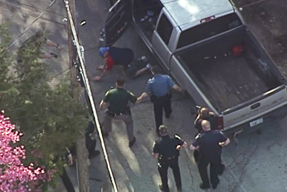 Images made from a helicopter video provided by WHDH in Boston showed Richard Simone putting his hands on the ground after a high-speed chase that ended in Nashua, N.H. Moments later officers rushed Simone and pummeled him.