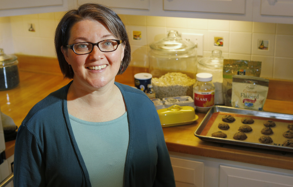 Postpartum doula Jessica Thomas. In the background are some of Thomas' lactation cookies.